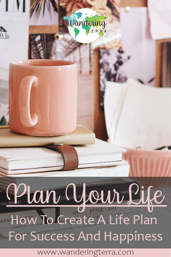 Plan Your Future: How to Create a Life Plan to Build a Future of Success and Happiness - pink mug sits on books and notepads on desk covered with trinkets, notes, plants, photographs and a life plan pin for Pinterest